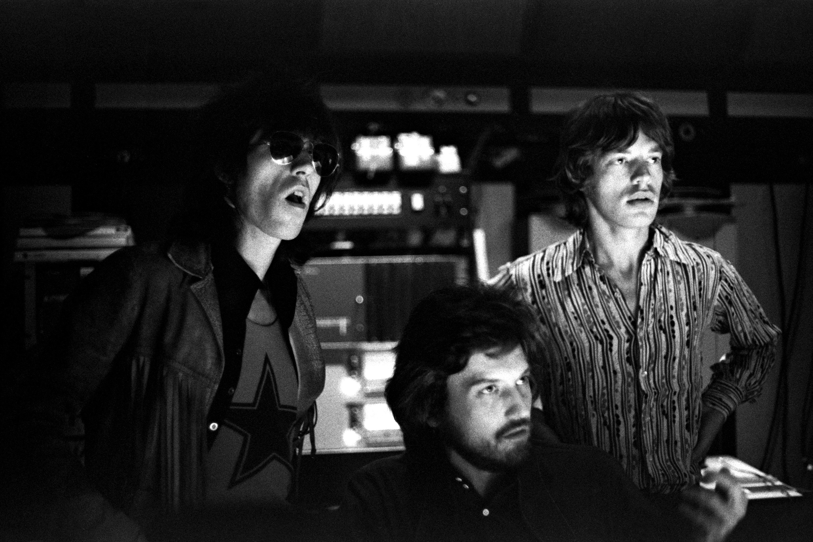 """English musicians Keith Richards and Mick Jagger of the Rolling Stones along with producer Jimmy Miller work on the mixing of their """"Let It Bleed"""" album at The Elektra Studios in October, 1969 in Los Angeles, California."""