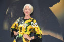 Helen Mirren, sporting a lovely, silver bob, shows  how to grow old  gracefully