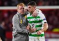 Celtic's Ryan Christie (R) and manager Neil Lennon at full-time of the UEFA Europa League Group E match between Stade Rennais and Celtic at Roazhon Park, on September 19, in Rennes, France