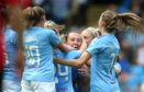 Manchester City Women's Caroline Weir (centre) celebrates with teammates