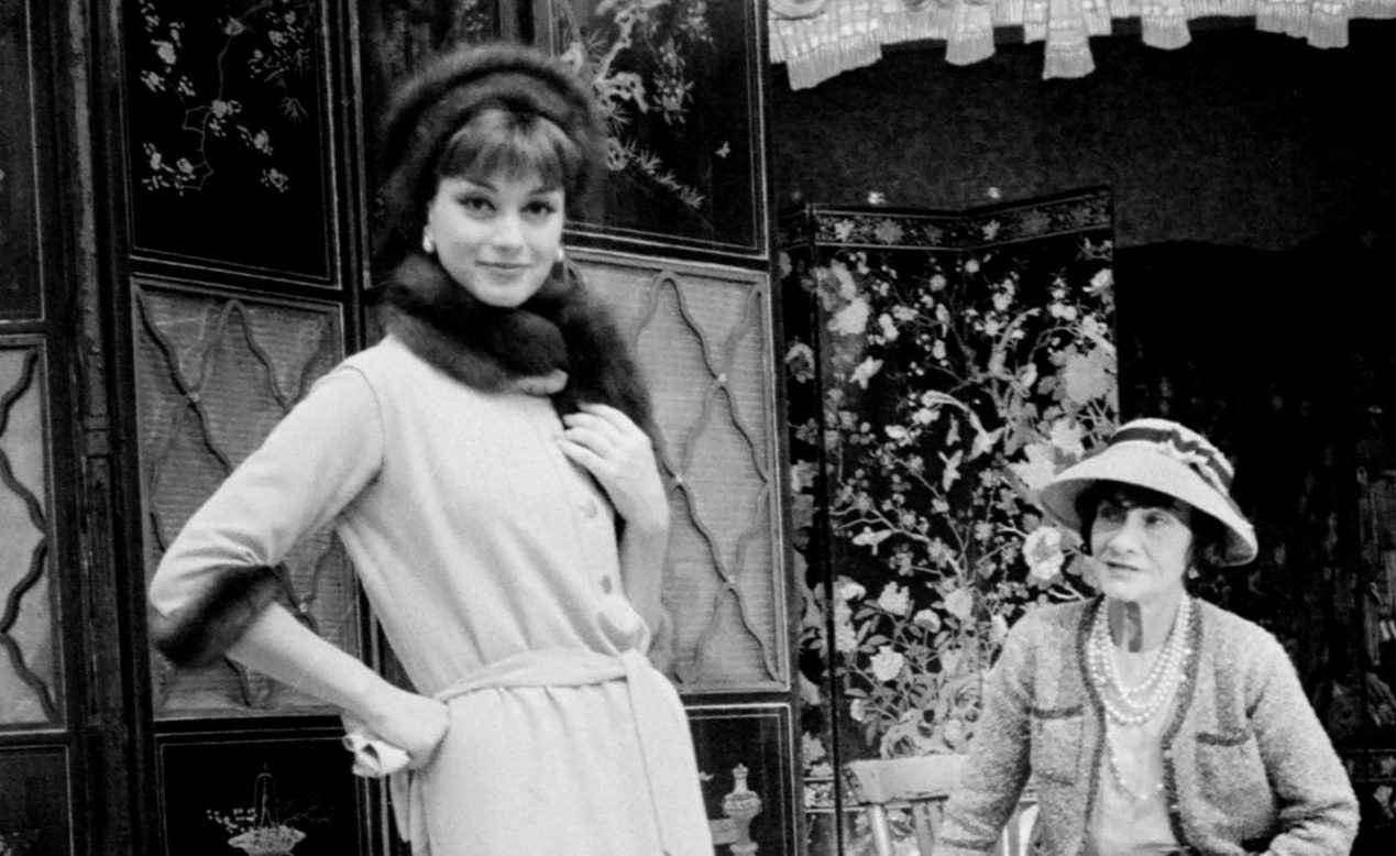Coco Chanel with a model in Paris, in August 1958