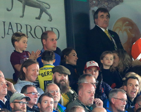 Prince George of Cambridge,  Prince William, Duke of Cambridge and Catherine, Duchess of Cambridge and Princess Charlotte of Cambridge are seen in the stands during the Premier League match between Norwich City and Aston Villa at Carrow Road.
