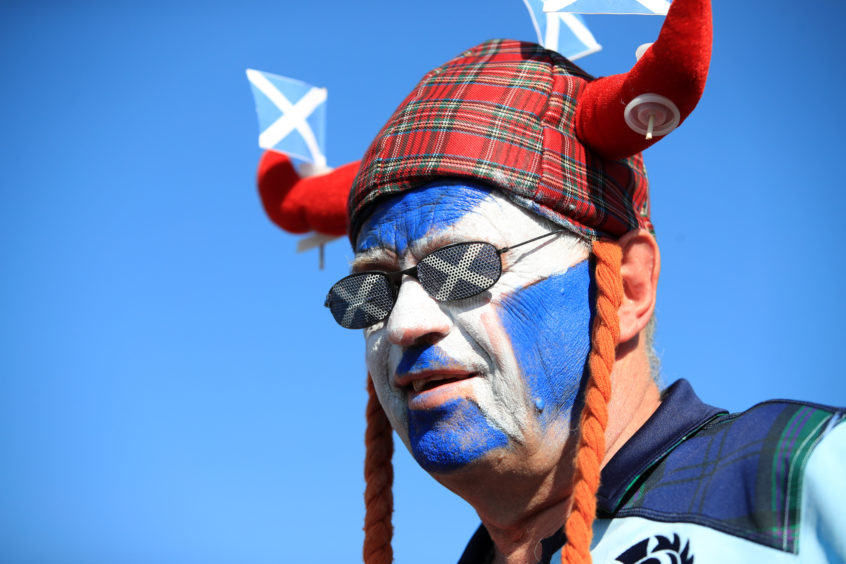 A Scotland fan arrives for the match