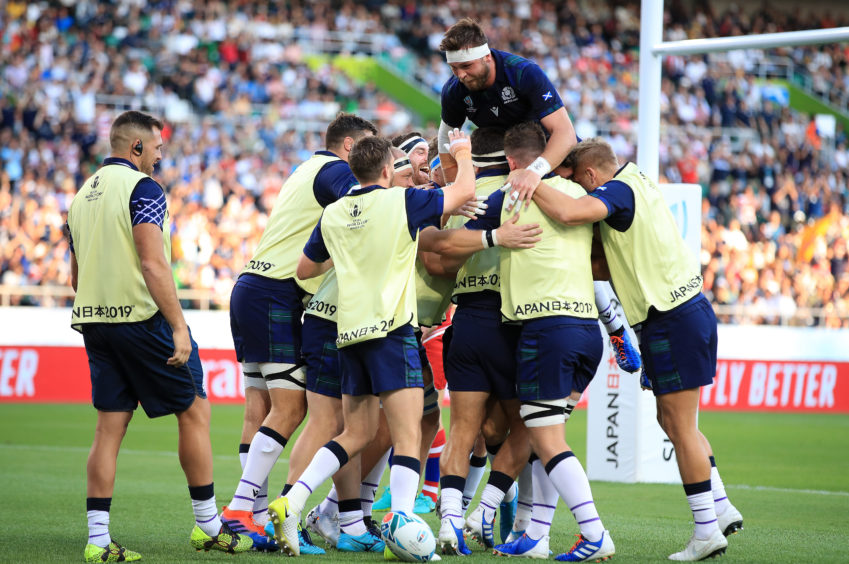 Scotland players celebrate the second try