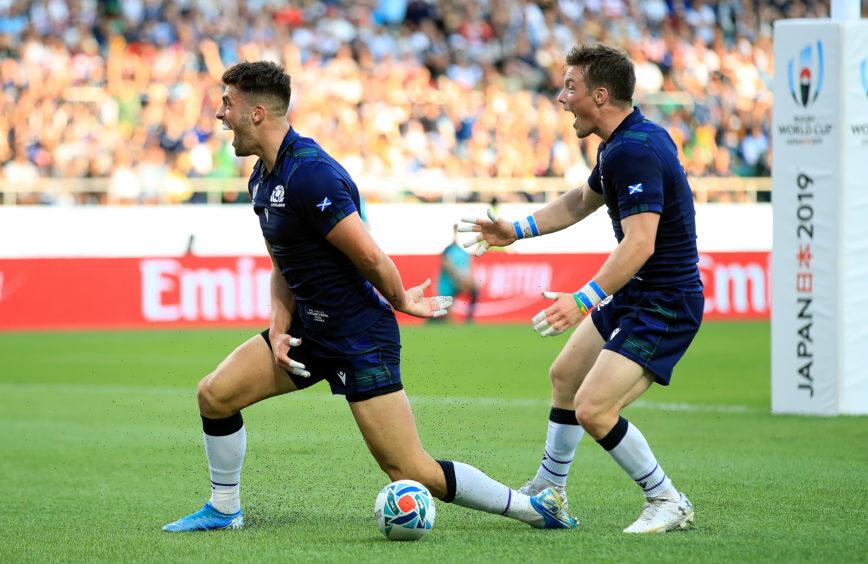 Scotland's Adam Hastings (left) celebrates scoring his side's second try