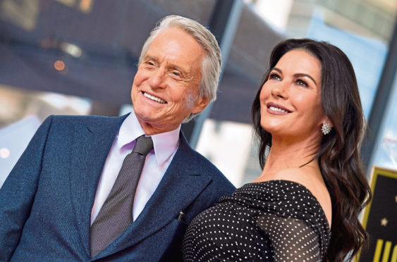 HOLLYWOOD, CA - NOVEMBER 06:  Michael Douglas and Catherine Zeta-Jones attend the ceremony honoring Michael Douglas with star on the Hollywood Walk of Fame on November 06, 2018 in Hollywood, California.  (Photo by Axelle/Bauer-Griffin/FilmMagic)