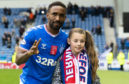 Jermain Defoe celebrates his hat-trick against Hamilton Accies last weekend with young fan Amber Smith