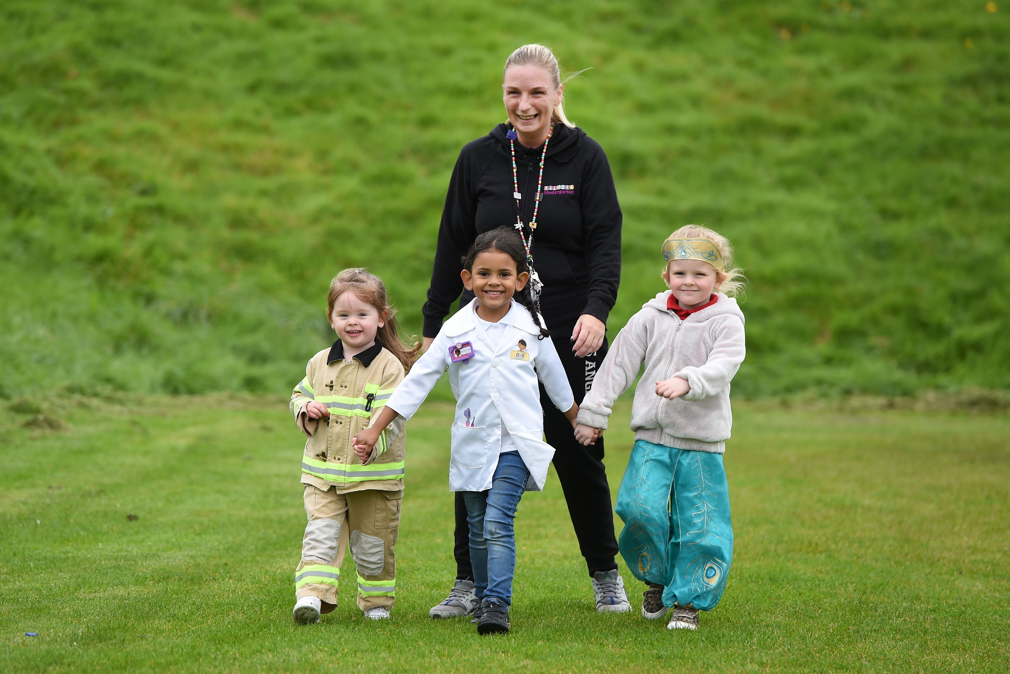 Children from Balmore Kindergarten in Glasgow dress up as what they want to be when they're older as part of a sponsored walk to raise money for young people affected by poverty.