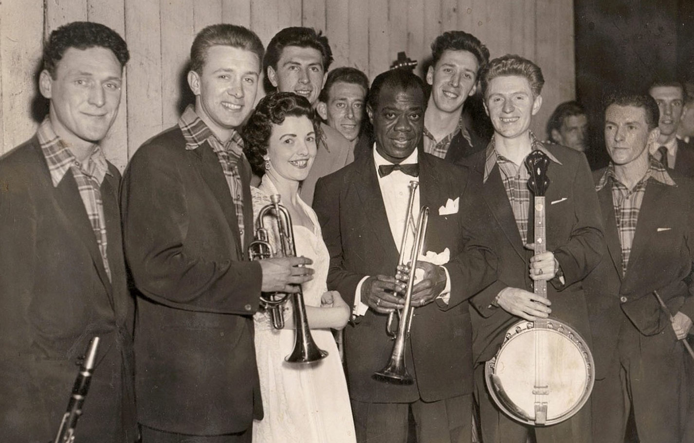 Mary McGowan, with jazz legend Louis Armstrong, centre, and the Clyde Valley Stompers