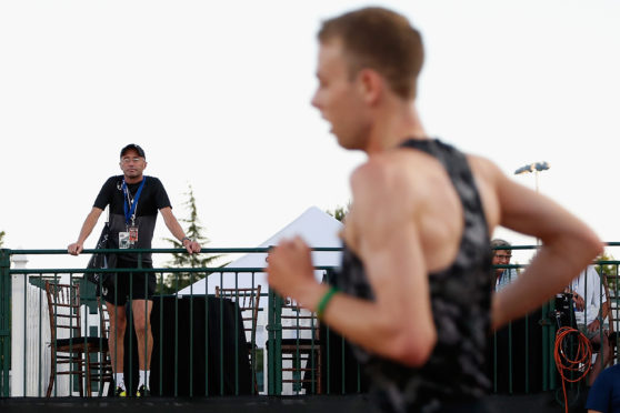 Alberto Salazar, left, looks on as Galen Rupp competes in Eugene, Oregon in 2015