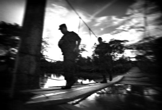Members of the anti-guerrilla police on patrol in Bellavista, on the Atrato River
