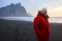 Sir David Attenborough on location filming Seven Worlds, One Planet on Stokksnes beach in Iceland