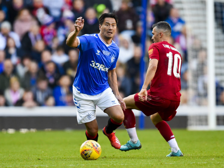 Michael Mols and Luis Garcia in action