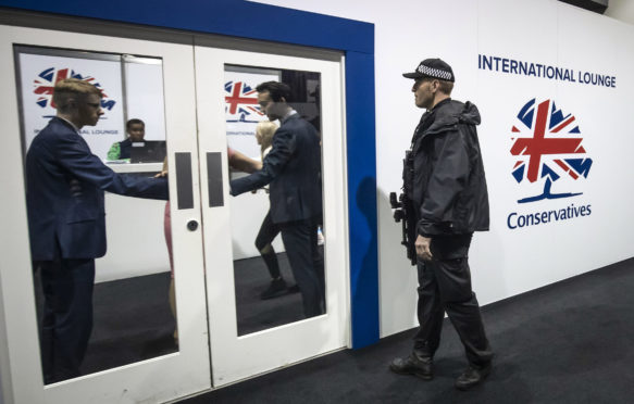 Police arrive at the Conservative Party Conference