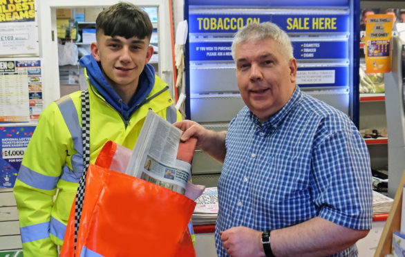 Liam Scobie with Des Barr from Sinclair Barr newsagents