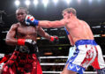 Logan Paul (red/white/blue shorts) and KSI (black/red shorts) exchange punches during their pro debut fight at Staples Center on November 9, 2019 in Los Angeles, California. KSI won by decision.