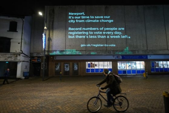 the It's Our Time Campaign of one of their wall projections in Newport, as under-18s and celebrities have helped launched the campaign aiming to motivate young people concerned about climate change to sign up to vote before the registration deadline on November 26.