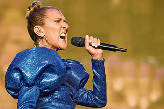 Celine Dion performing at a concert in Hyde Park in July