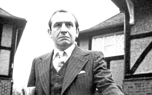 Leonard Rossiter as Reginald Perrin, 1976