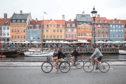 Tourists biking at Nyhavn, Copenhagen