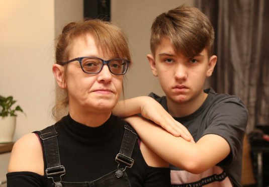 Caroline MacDonald and her son Mac, 14, are still grieving the loss of Shaun