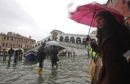 People walk near the Rialto bridge