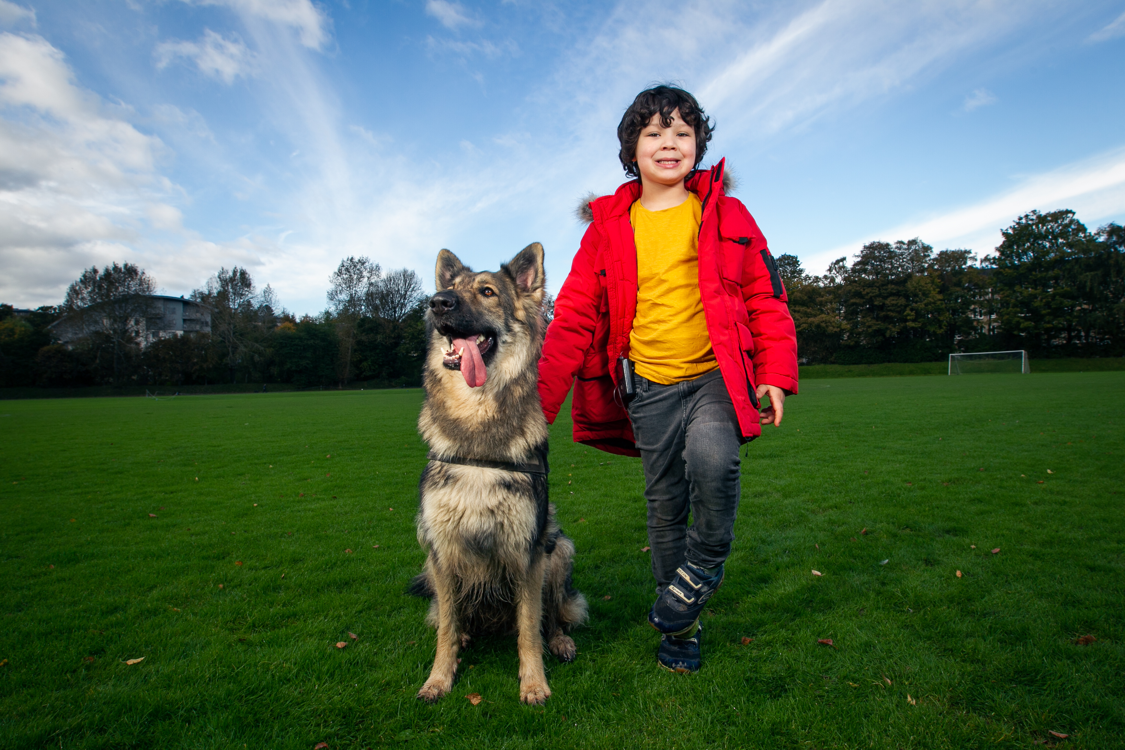 Six-year-old Jacob with pet German Shepherd Noble who alerts family members whenever Jacob's blood sugar levels drop too low