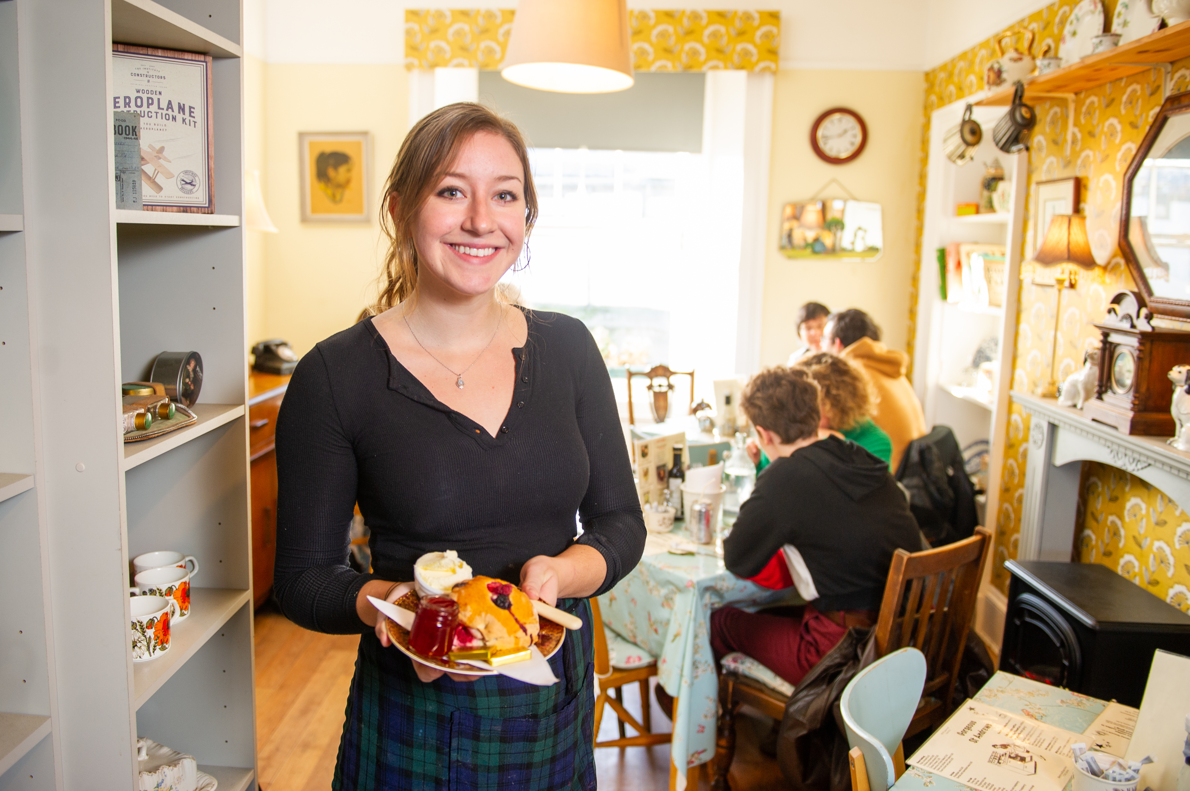 Claire Wever with one of the cafe's signature Prince of Cambridge scones