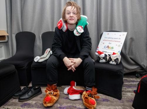 Lewis Capaldi poses in his Christmas socks last year, to help raise awareness of Festive Friday, CHAS's Christmas appeal.