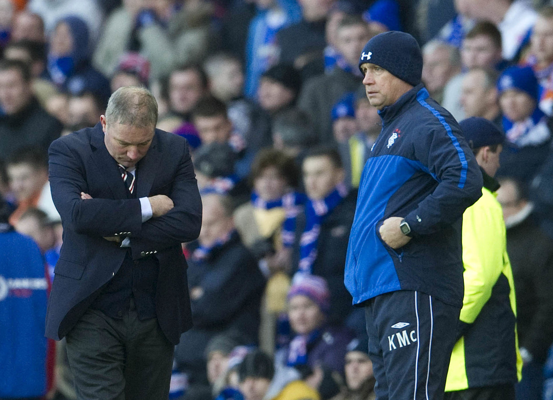 Rangers manager Ally McCoist looks to the turf as assistant Kenny McDowall (right) looks on