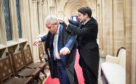 Departed Speaker John Bercow is helped prepare for a Commons session