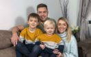 Mike Fraser with wife Louise and sons David and Daniel at home in Inverness