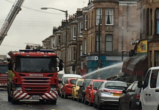 "Firefighters were still at the scene on Tuesday afternoon carrying out an ""extensive dampening down operation"""