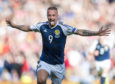 Leigh Griffiths celebrates his first goal against England