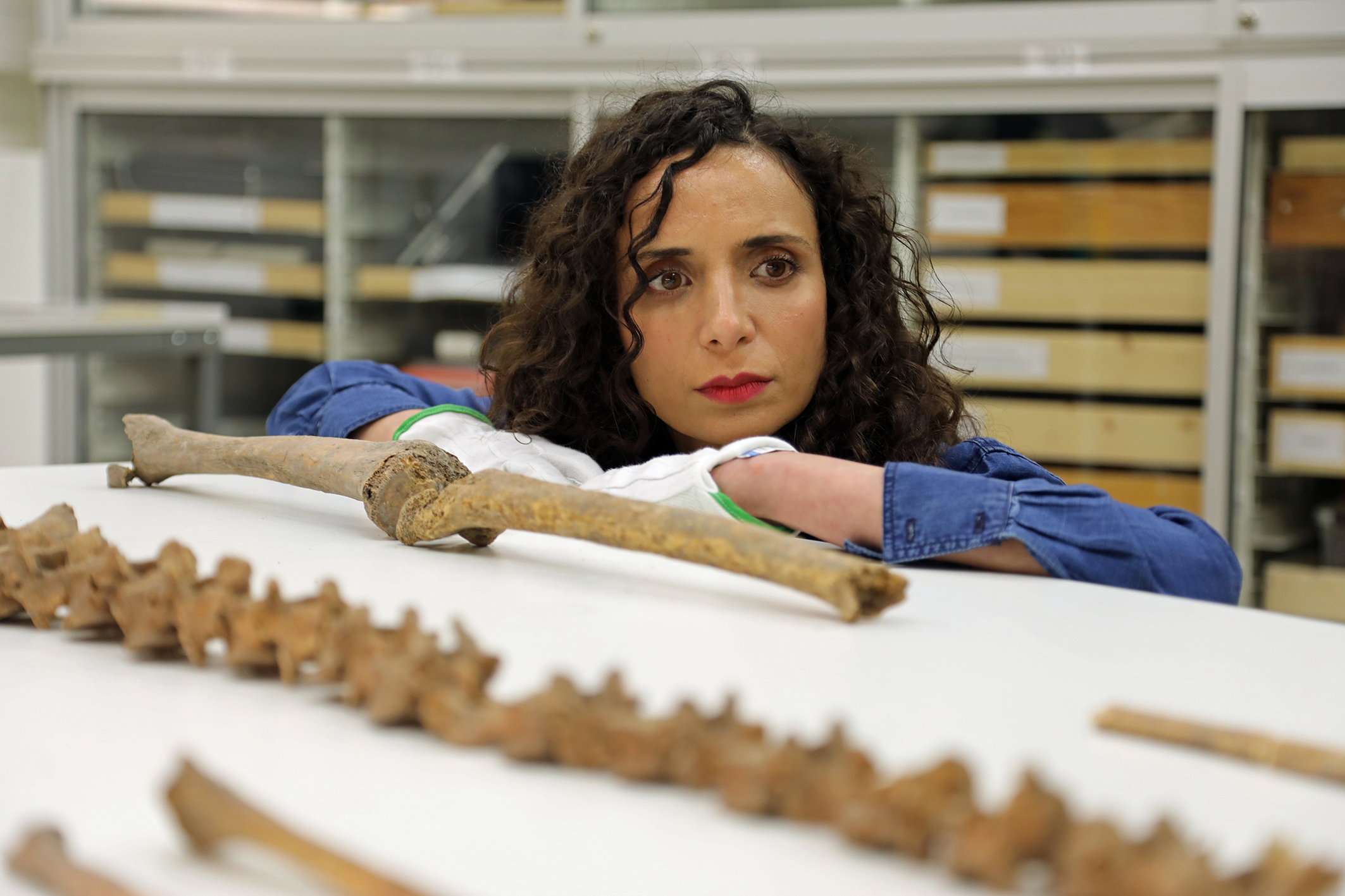 Ella Al-Shamahi with the bones of a Viking warrior in Stockholm's Swedish History Museum
