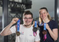 Scott McLay and Hannah Miley show off the new medals
