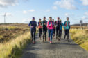 Kirsty Aplin, Allie Bailey, Lorna Spayne,  Anna Brown, Laura Fisher, Gillian McColl,  Kim Hopkinson, Amanda Butler and Alice Kirk ran through moors, on road, at night and on beaches during their record-breaking adventure