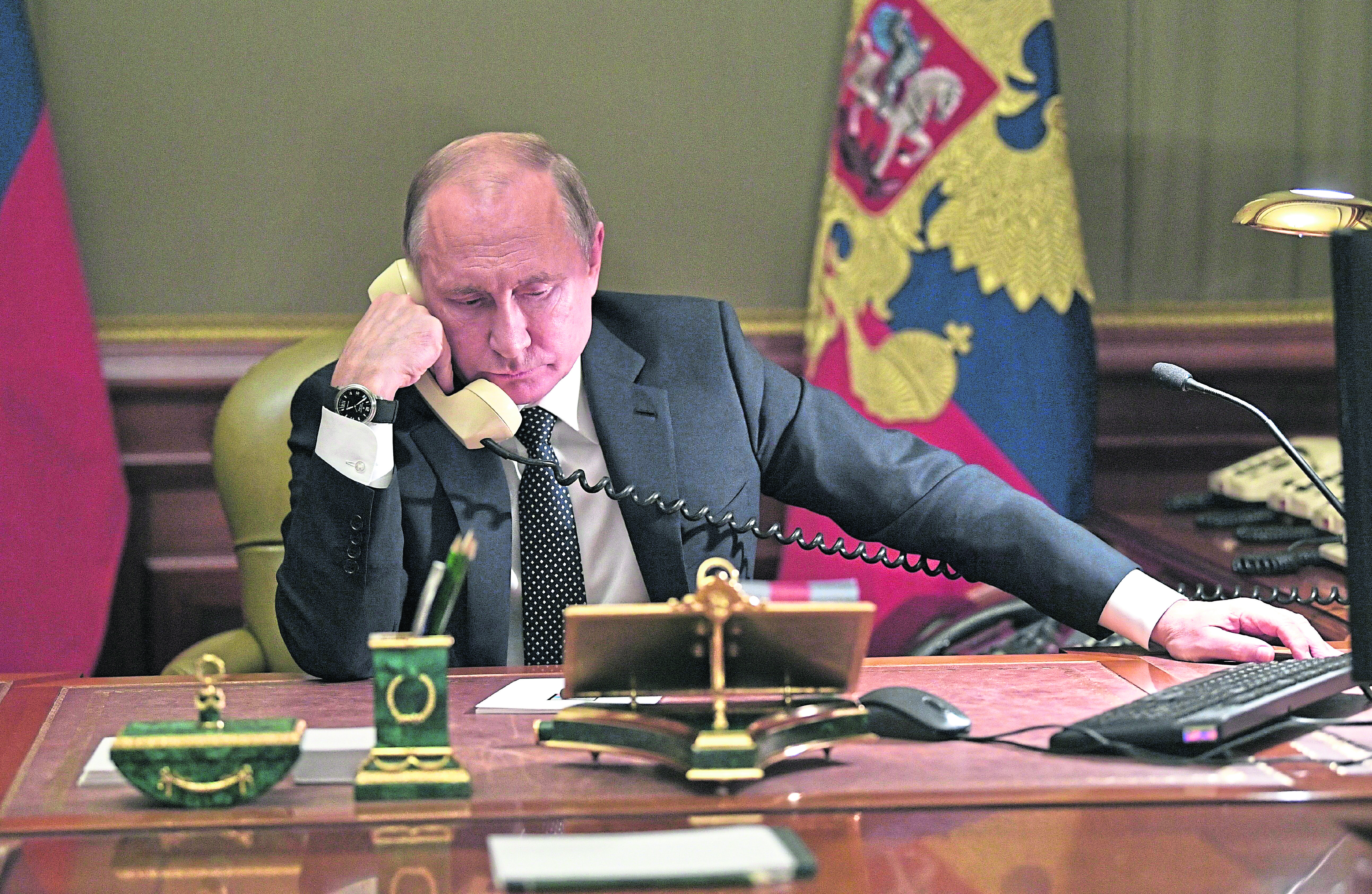 Vladimir Putin, putting in a call from his office in Moscow, has been accused of complicity
