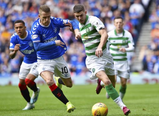 Ryan Christie takes on Rangers' Steve Davis at Ibrox in the first Old Firm game of the season