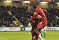 Jermain Defoe (L) celebrates making it 3-0 against Hibs with Glen Kamara