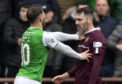 Little festive cheer between Michael Smith and Martin Boyle on Boxing Day