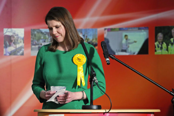 Lib Dem leader Jo Swinson reacts as she loses her East Dumbartonshire seat.