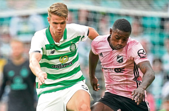 Kristoffer Ajer of Celtic  and Reginald Mbu Alidor of Nomme Kalju