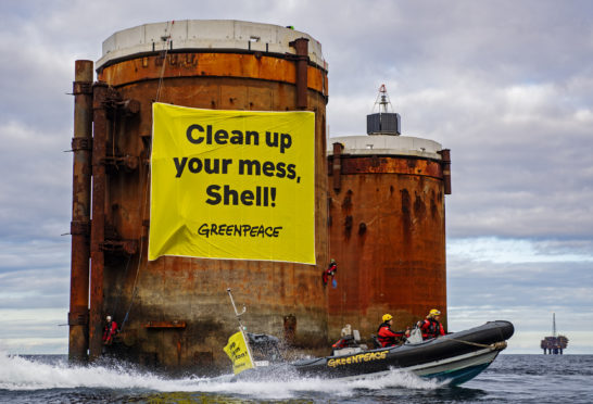 Greenpeace activists from the Netherlands, Germany and Denmark boarded two oil platforms in Shell's Brent field in a peaceful protest against plans by the company to leave parts of old oil structures with 11,000 tons of oil in the North Sea.  Climbers, supported by the Greenpeace ship Rainbow Warrior, scaled Brent Alpha and Bravo and hung banners saying, 'Shell, clean up your mess!' and 'Stop Ocean Pollution'.