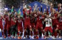 Liverpool celebrate their Champions League win in Madrid last May
