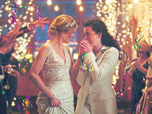 Under pressure from a conservative advocacy group, The Hallmark Channel has pulled the ads for wedding-planning website Zola that featured same-sex couples, including two brides kissing.