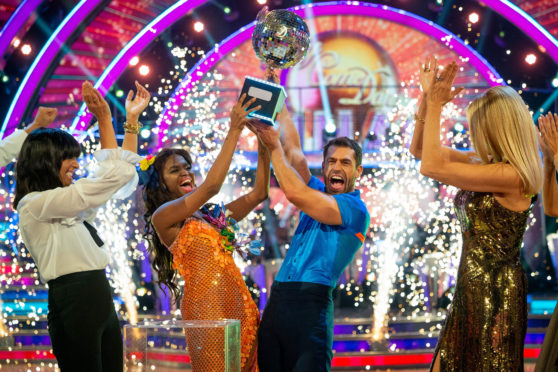 Kelvin Fletcher and Oti Mabuse lift the trophy