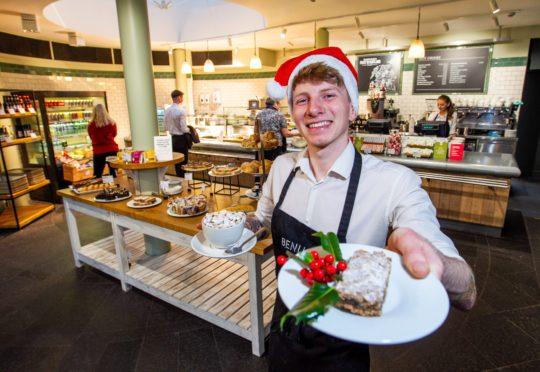Waite, Morgan McKnight serving mince pie slice