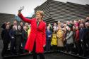 Nicola Sturgeon celebrates with the SNP's elected MPs
