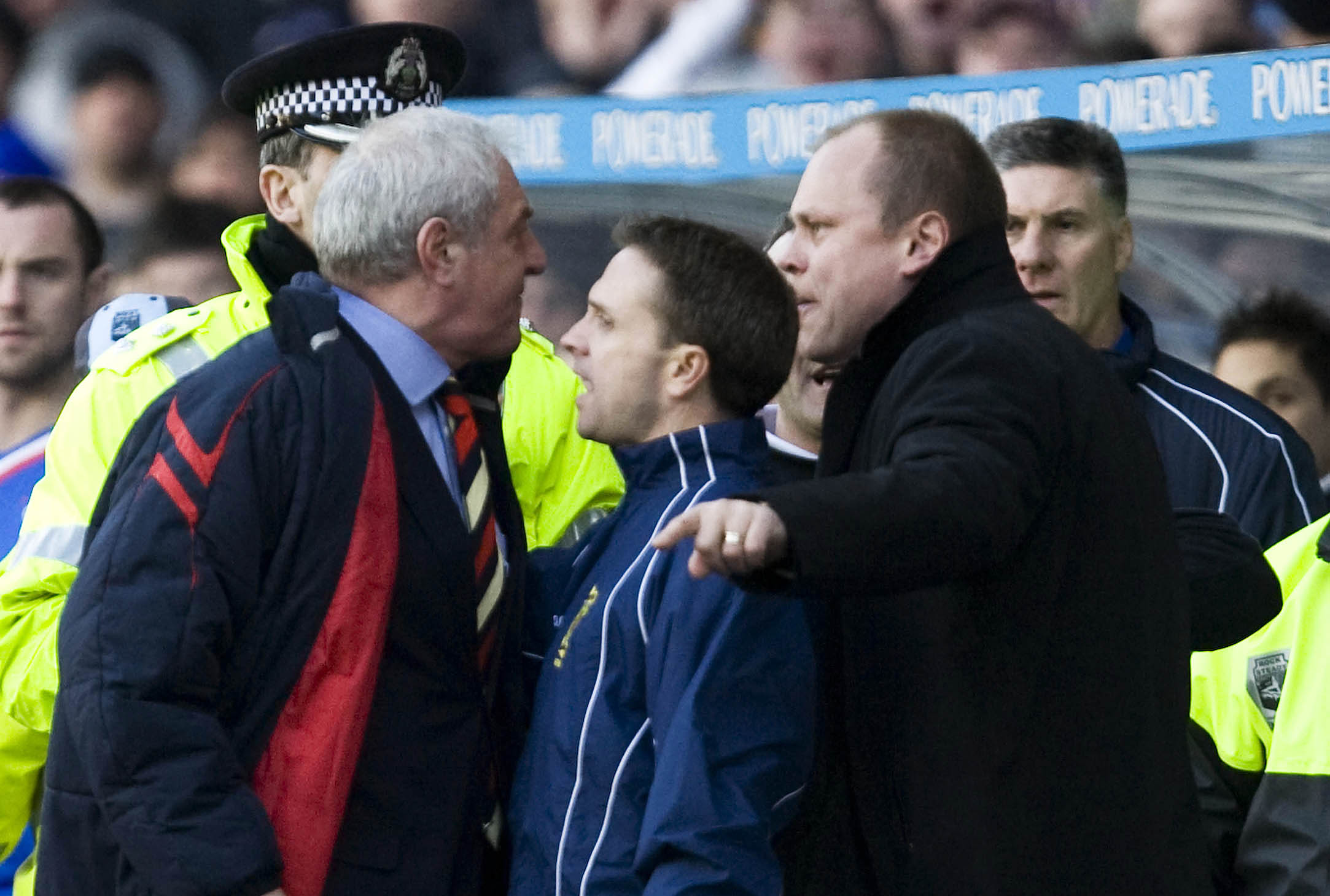 March 2008, and Crawford Allan has to separate Walter Smith and Mixu Paatelainen during a Scottish Cup tie at Ibrox